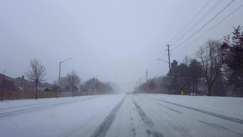 *Brighter Version* Driving Winter Snow Storm With Vehicle Traffic in Day. Driver Point of View POV Live Action