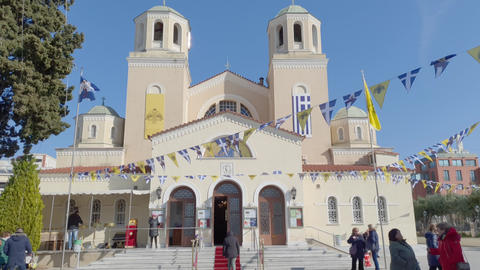 Orthodox church facade with Hellenic & Greek Orthodox Church waving flags Live Action