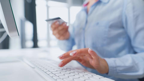 Female hands typing credit card number on computer keyboard. Woman making online Live Action