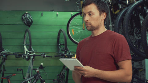 theme of small business selling bicycles. Young Caucasian male brunette small Live Action