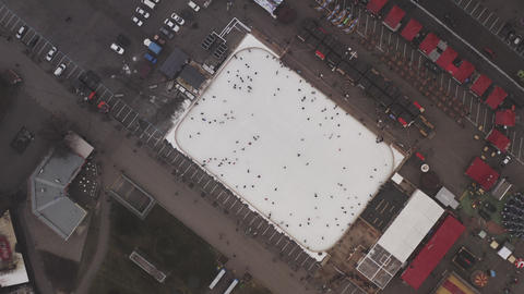 People skating and slide on the ice rink in January, in winter. Entertainment Live Action