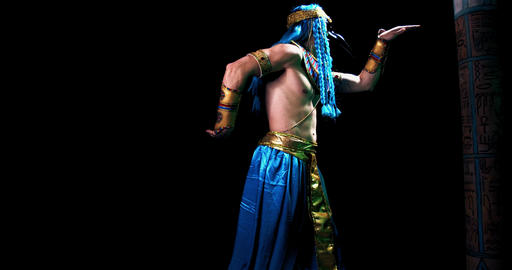 Egyptian deity Thoth with the head of ibis is dancing on black background, 4k Live Action