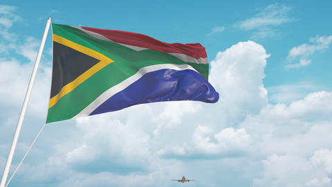 Plane arrives to airport with flag of South Africa. South African tourism Live Action