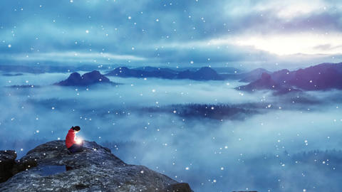 Woman hold lantern of life. Magical milky misty landscape. Woman sit on top of mountain with bright Live Action