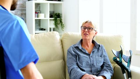 Male nurse and senior woman having a conversation Live Action