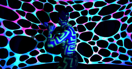 Glowing ultraviolet body art on a man dancing in the dark, colorful, 4k Live Action