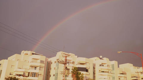 Rainbow in the city. Winter in Israel Live Action