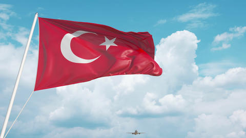 Commercial airplane landing behind the Turkish flag. Tourism in Turkey Live Action
