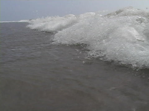 Waves roll to the shore from the ocean Stock Video Footage