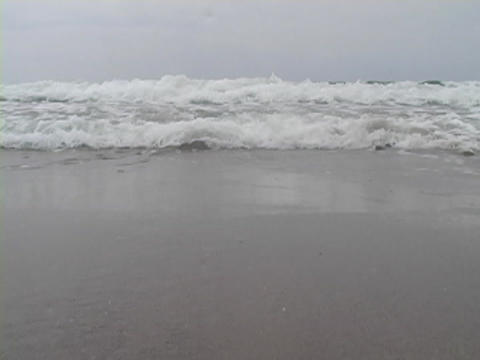 The surf rolls onto the shore Stock Video Footage
