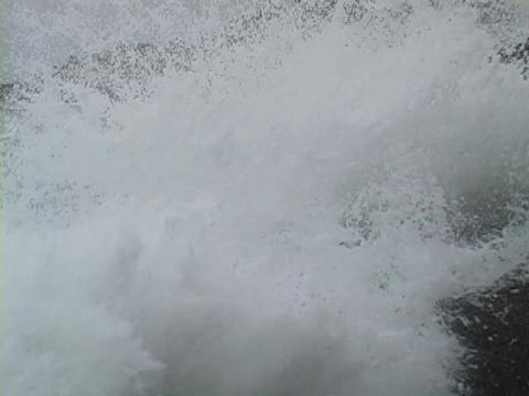 Waves splash against rocks as they hit the shore Stock Video Footage
