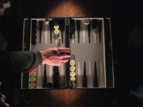 people play a game of backgammon Stock Video Footage