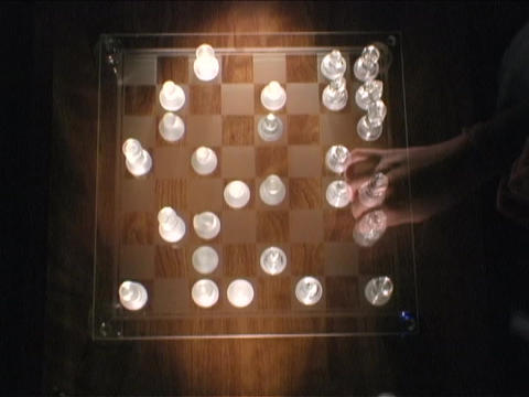 Chess player move chess pieces on a game board Footage