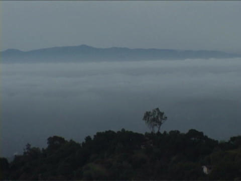 Fog rolls over the mountains in Santa Barbara, California Stock Video Footage