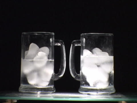 Ice melts in a glass Footage