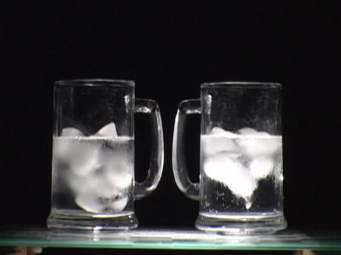 Ice melts in a glass Stock Video Footage