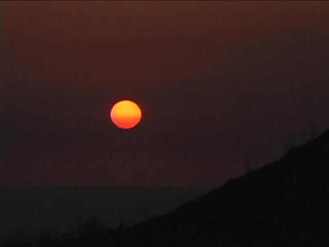 The sun glows at golden hour over the mountains in Santa Barbara Footage