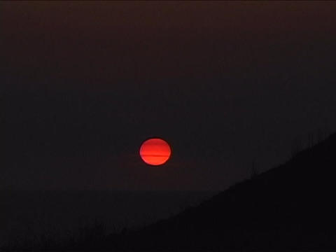 The sun glows at golden hour over the mountains in Santa... Stock Video Footage