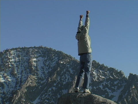 A hiker achieves his victory when he reaches the... Stock Video Footage