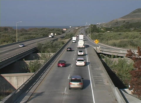 Traffic travels on a divided coastal highway Stock Video Footage