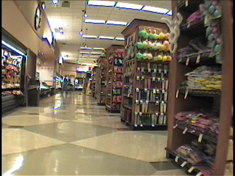 Shoppers pass through a supermarket Stock Video Footage