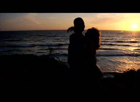 A couple embraces beside the sea Footage