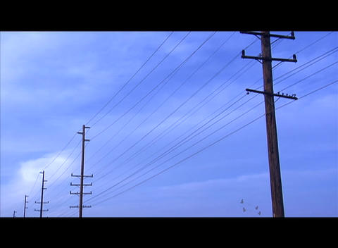 Shoes are thrown over a telephone line Stock Video Footage