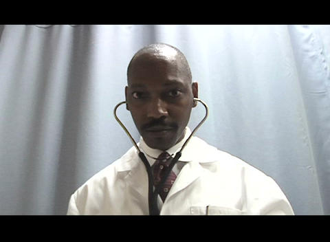 A doctor with a stethoscope prepares to take a heartbeat reading Footage