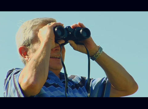 A man looks through binoculars Stock Video Footage