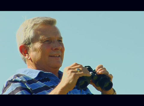 A man looks through binoculars Footage