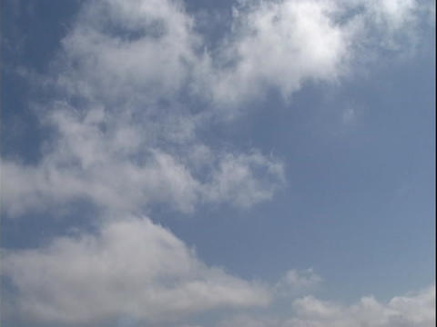 Clouds Drift Gently In A Blue Sky stock footage
