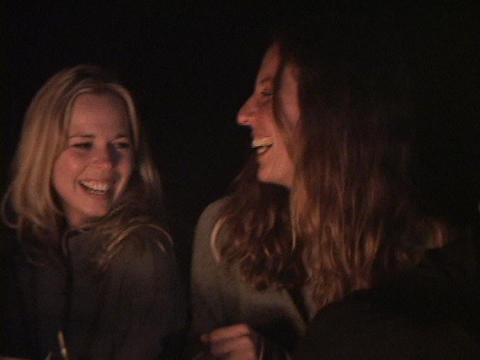 Campers enjoy songs around a campfire Stock Video Footage