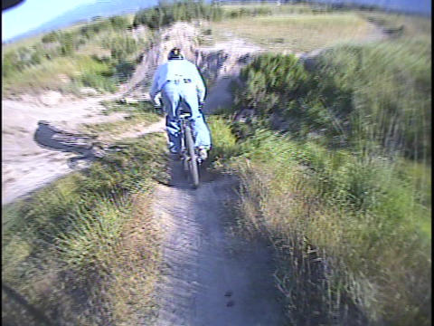 A mountain biker rides over a trail Footage
