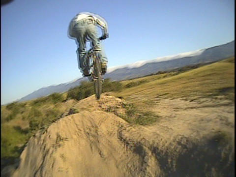 A mountain biker rides over a trail Stock Video Footage