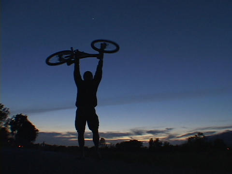 A mountain biker picks up his bike in victory Stock Video Footage