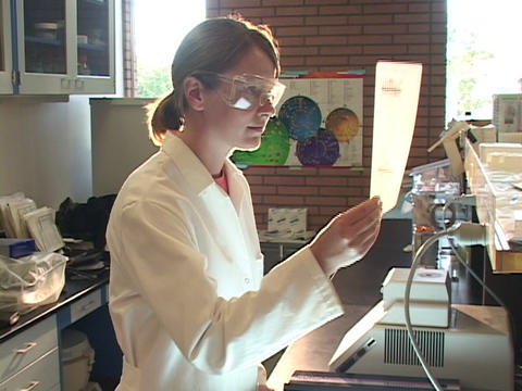 A medical technician works in a lab Stock Video Footage