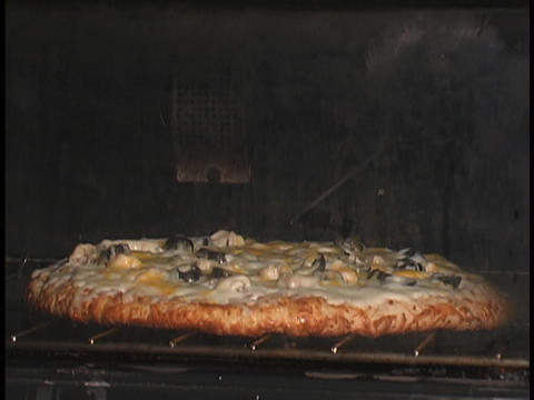 A pizza cooks in an oven Stock Video Footage