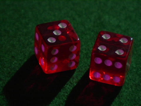 red dice sit on a green table Footage