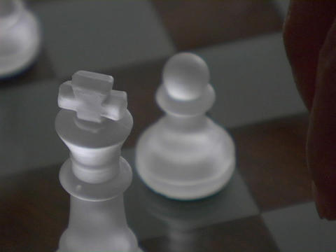 A chess player moves a knight Stock Video Footage