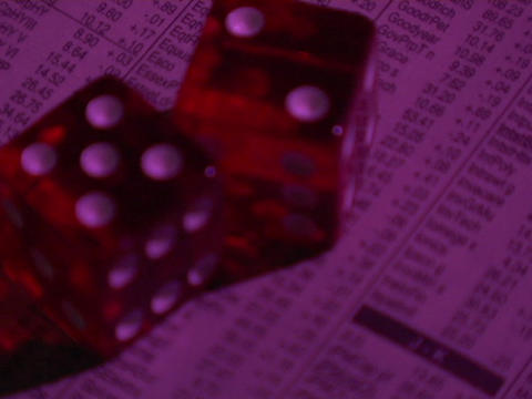 dice sit on the stock market page of a newspaper Stock Video Footage