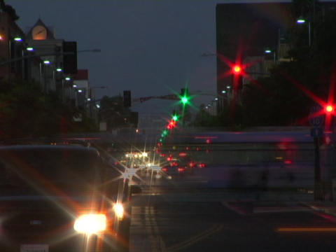 Traffic moves quickly down a street Stock Video Footage