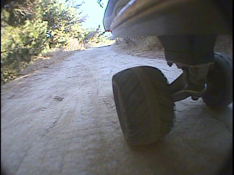 Skateboard wheels roll over a bumpy path Stock Video Footage