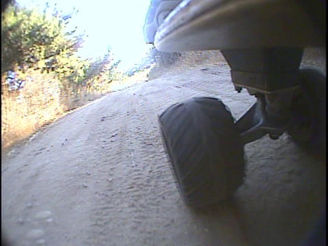 Skateboard wheels roll over a bumpy path Footage