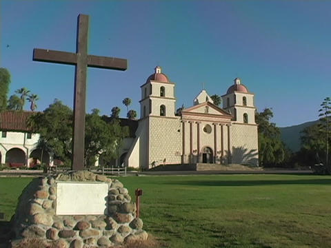 A plain cross embedded in stone occupies the lawn in... Stock Video Footage