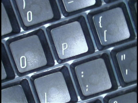 Letters and punctuation marks make up a computer keyboard Stock Video Footage