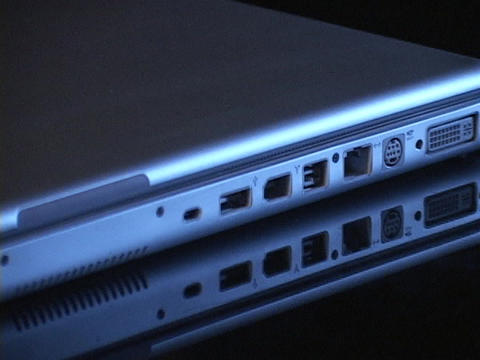 A firewire, USB port, and computer outlets line the edge of a laptop computer Footage