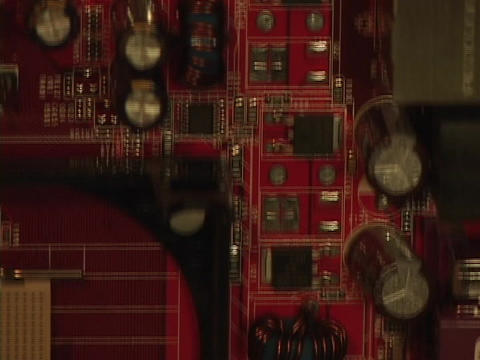 Chips and components lie in a motherboard Stock Video Footage