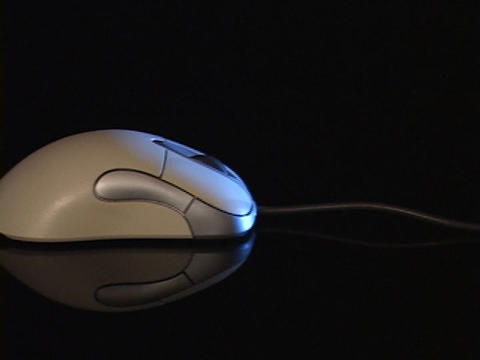 A cord leads to a computer mouse Footage