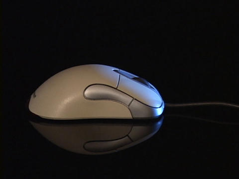 A cord leads to a computer mouse Stock Video Footage