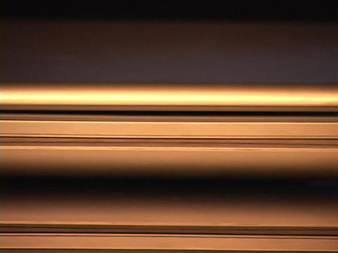 The edge of a laptop computer reflects silver light Stock Video Footage